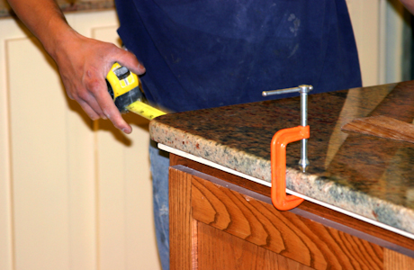 flooring mo tile blue company springs countertops floor mg install and in granite countertop installing insulation hardwood